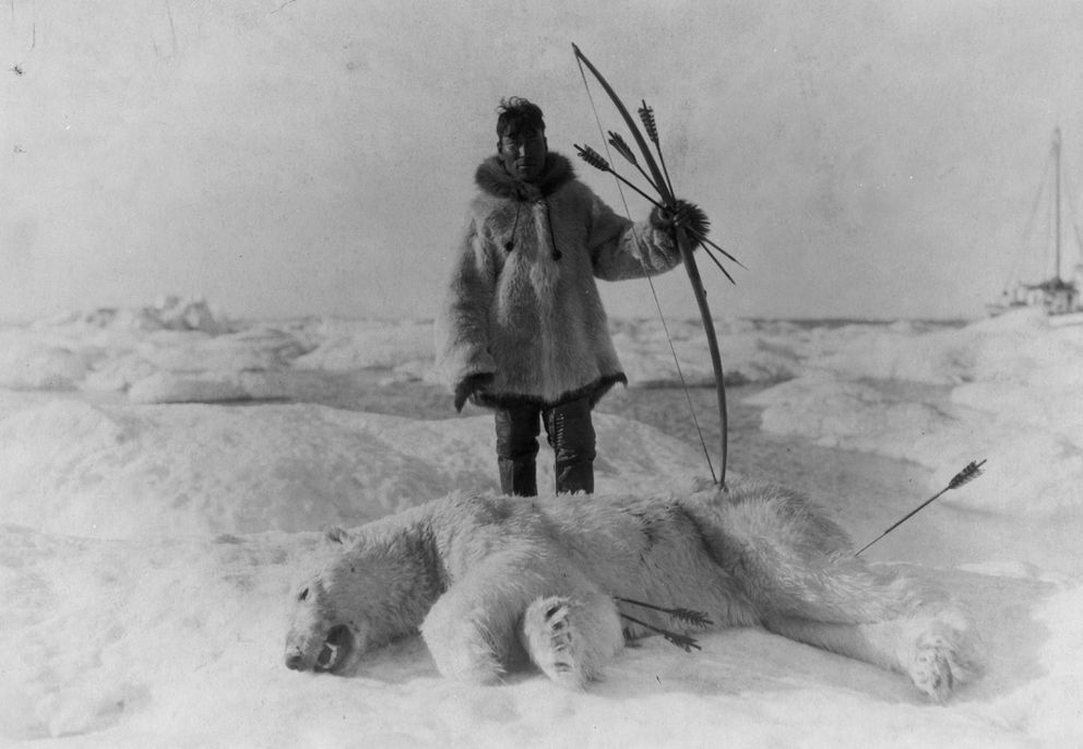 """Inupiaq hunter and polar bear, circa 1924. (This photo actually shows the re-enactment of a traditional hunt for a silent movie like Robert J. Flaherty's """"Nanook of the North"""" but was filmed in Nome, Alaska.) Courtesy of Library of Congress."""