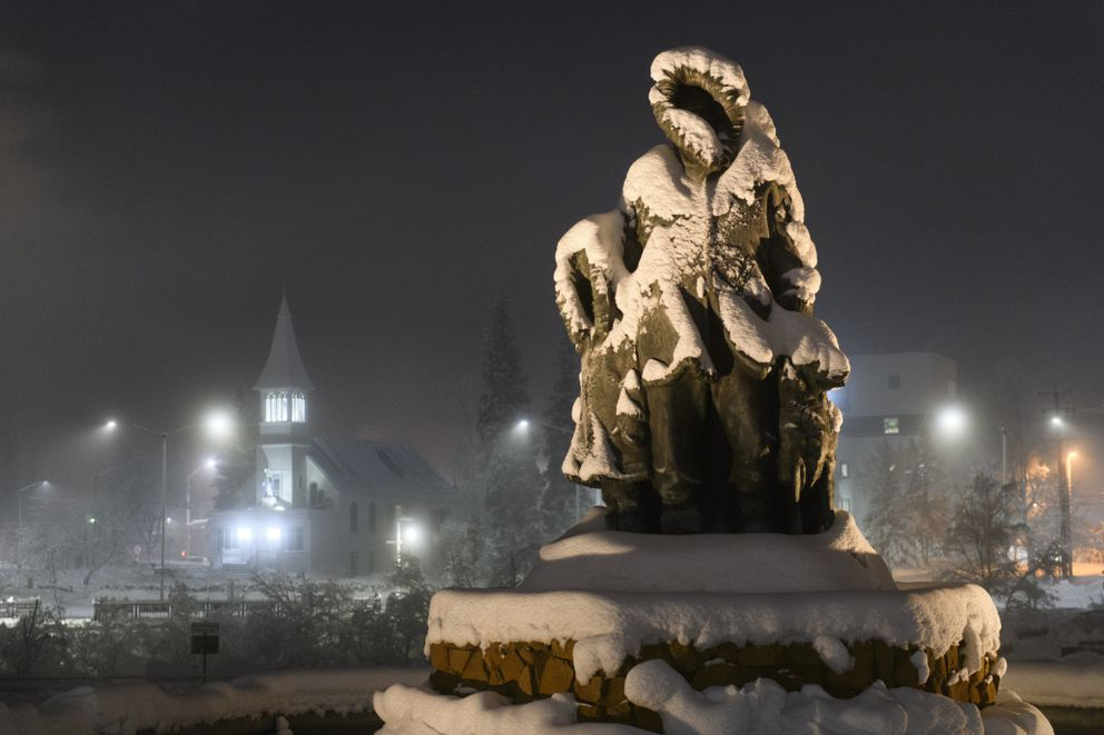 Frost and snow cover a statue in Golden Heart Plaza in downtown Fairbanks on Jan. 8, 2020. (Marc Lester / ADN)