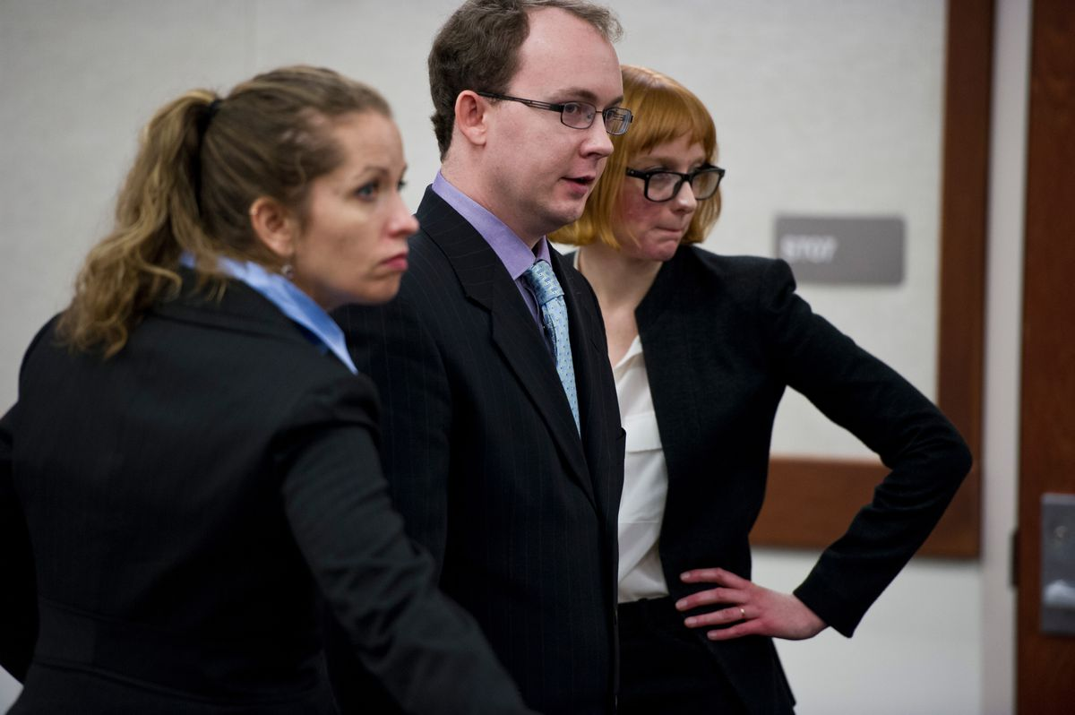 A jury began hearing testimony in the murder trial for Clayton Allison, center, on January 15, 2015, in Palmer. Allison was charged with homicide in the death of his 15-month-old daughter, Jocelynn Allison, who died in 2008. He is pictured with lawyers Hannah Thorssin-Bahri, left, and Ariel Toft, right, both of the state public defender's office. (ADN archive)