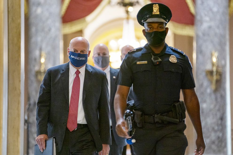 FILE - In this Aug. 5, 2020, file photo Postmaster General Louis DeJoy, left, is escorted to House Speaker Nancy Pelosi's office on Capitol Hill in Washington. (AP Photo/Carolyn Kaster, File)
