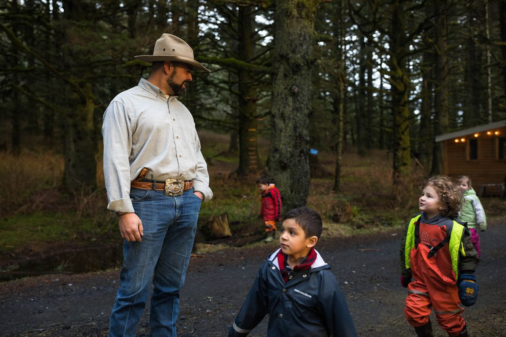 Josh Bell, outdoor programs director for the Kodiak Baptist Mission, smiles at passing children that are enrolled in the mission's school on Thursday, Jan. 24, 2019. Around 42% of the children in the school come from Coast Guard families. (Loren Holmes / ADN)
