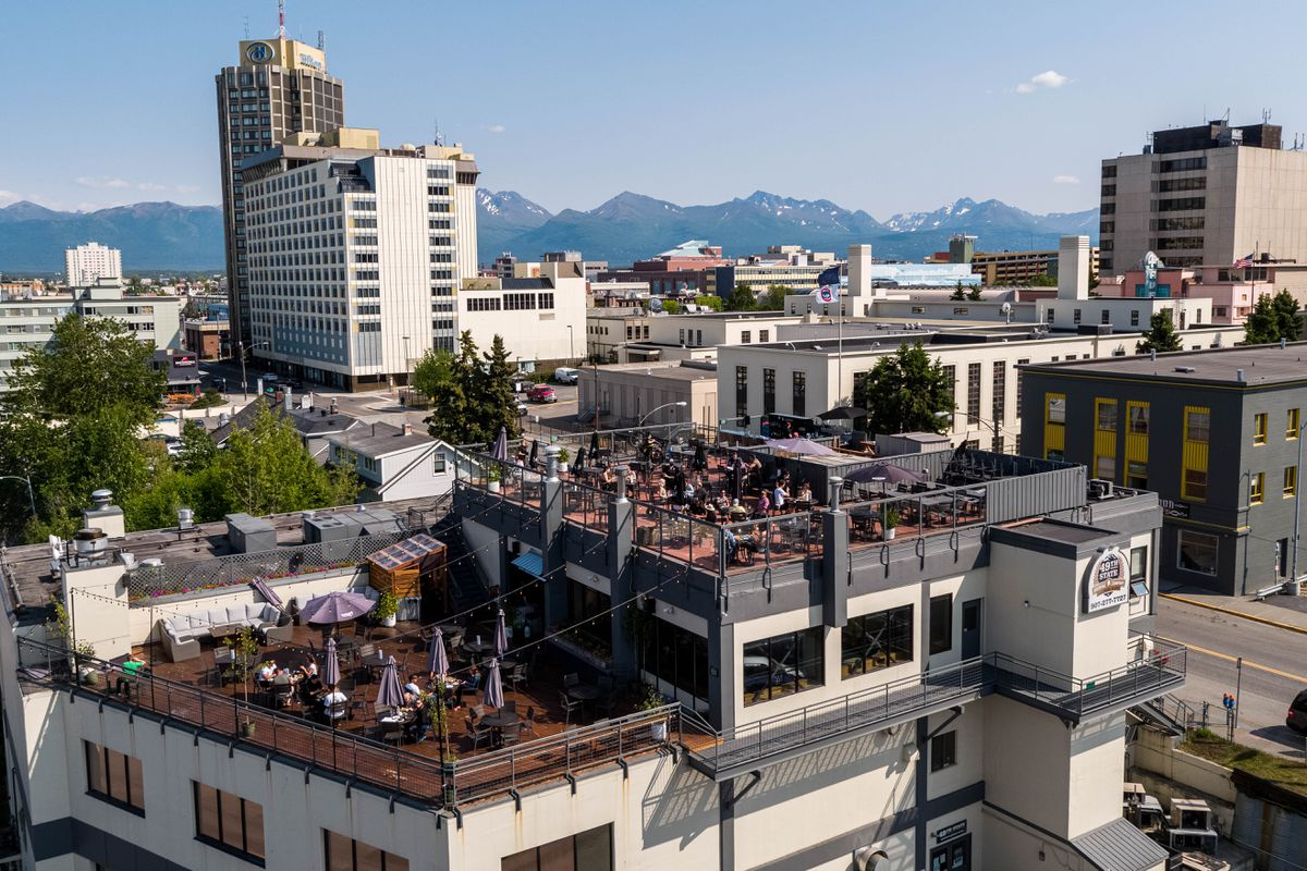 People dine on the outdoor patios at 49th State Brewing Company on Wednesday, July 1, 2020 in downtown Anchorage. The city encouraged bars and restaurants to take advantage of a new streamlined process to add outdoor seating as much as possible to limit the spread of COVID-19. (Loren Holmes / ADN)