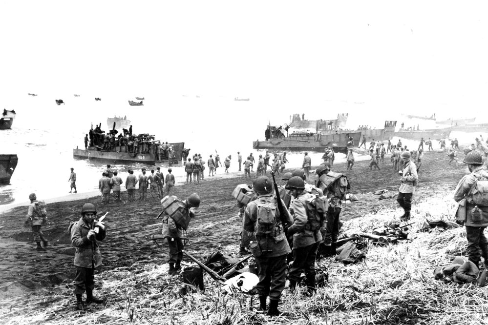 American soldiers and equipment are landed on the black volcanic beach at Massacre Bay on Attu Island, Alaska on May 26, 1943 during World War II. The U.S. troops will meet another force which has located the Japanese Army. (AP Photo/U.S. Navy)