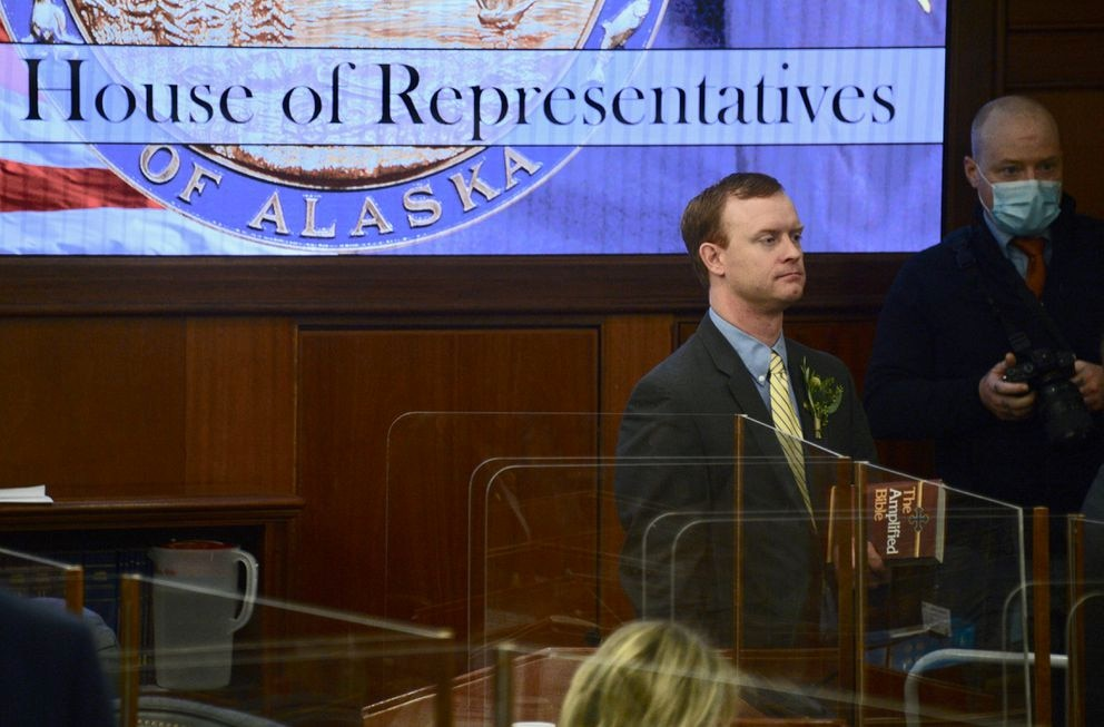 Rep. David Eastman, R-Wasilla, carries a Bible as he is sworn in for another term on Tuesday, Jan. 19, 2021 at the Alaska State Capitol in Juneau, Alaska. Legislators were allowed to remove their COVID-19 masks as they took the oath. (James Brooks / ADN)