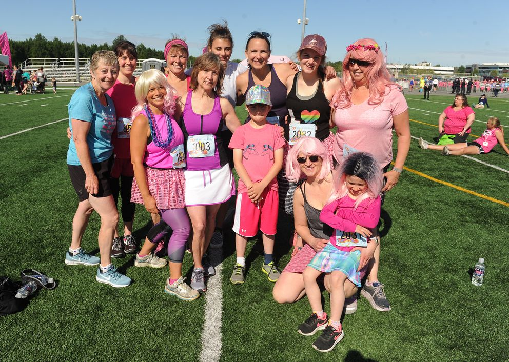 A group of runners and walkers pose for a post-race photo. (Bob Hallinen / ADN)