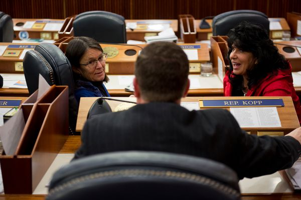 Reps. Jennifer Johnston, R-Anchorage, and Cathy Tilton, R-Wasilla, talk with Rep. Chuck Kopp on the House floor before the start of a session. Lawmakers in the Alaska House of Representatives and Senate closed their first week of work with floor sessions and committee meetings at the Capitol in Juneau on January 20, 2017, (Marc Lester / Alaska Dispatch News)