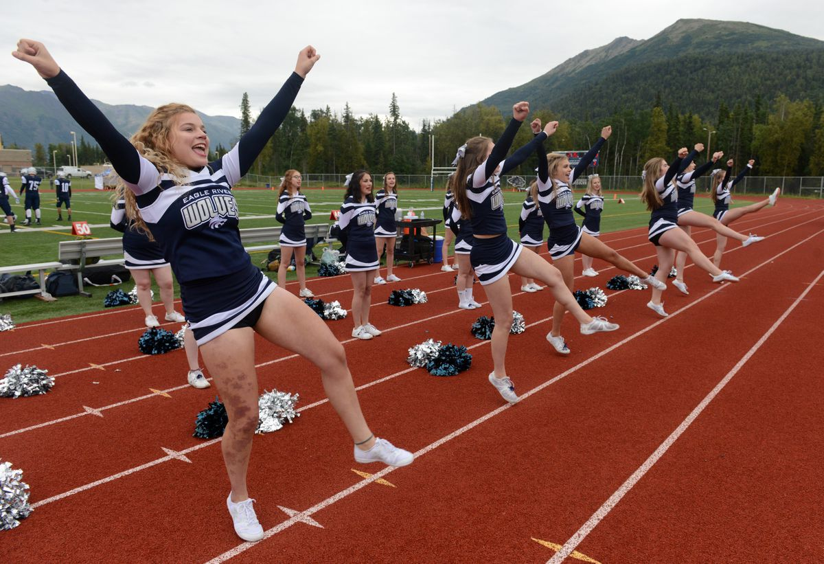 Eagle River cheerleaders celebrate a Week 2 touchdown by the Wolves, who are undefeated going into a big home game Saturday against the defending state champion Soldotna Stars. (Bob Hallinen / ADN)