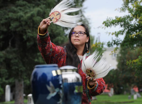 Polly Andrews dances to a Yup'ik / Cup'ik traveling song during the burial of Ray Mala, a cinematographer and Alaska's first movie star and his wife Galina Liss in the Anchorage Memorial Park Cemetery on August 20. (Bill Roth / ADN)