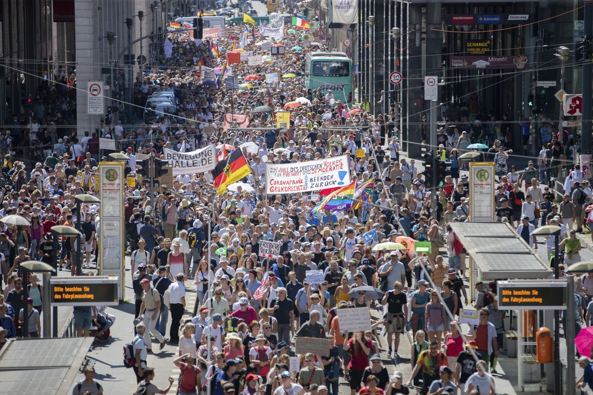 Thousands march along the 'Friedrichstrasse' during the demonstration against corona measures in Berlin, Germany, Saturday, Aug. 1, 2020. The initiative