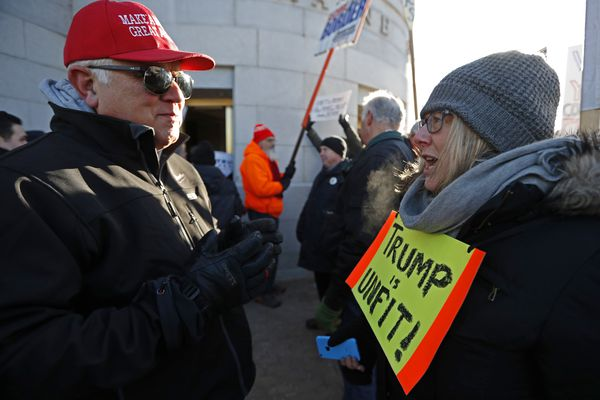 Donald Trump supporter Tom Thompson, left, of Topsham, Maine, and Lorry Fleming, right, of Bath, Maine, a Hillary Clinton supporter, argue outside the State House in Augusta, Maine, Monday, Dec. 19, 2016. Maine's electoral college voters split their vote with three ballots for cast for Democrat Clinton and one for Republican Trump. (AP Photo/Robert F. Bukaty)
