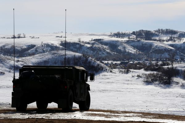 A North Dakota National Guard vehicle idles on the outskirts of the Dakota Access oil pipeline protest camp near Cannon Ball, North Dakota, U.S., January 29, 2017. REUTERS/Terray Sylvester