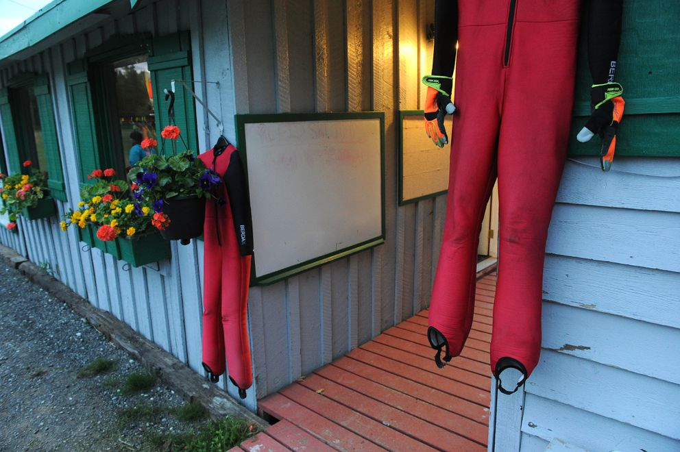 Jump suits are hung up during a break at the Midnight Sun Ski Jump-A-Thon.  (Bob Hallinen / ADN)