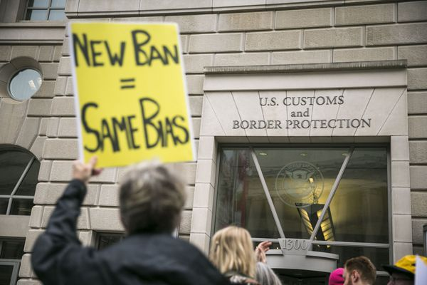 FILE -- Protesters demonstrate against President Donald TrumpÕs revised travel ban, outside the U.S. Customs and Border Protection headquarters in Washington, March 7, 2017. TrumpÕs new executive order sharply restricting travel from the Middle East is set to go into effect just after midnight Thursday, even as the measure faces an array of legal challenges from nonprofit groups and Democratic state attorneys general.(Al Drago/The New York Times)