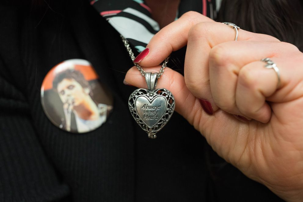 """Maria Rathbun wears a locket containing the ashes of her son, Mark Bolus, in her lawyer's office Friday. """"He's always close to me,"""" she said. (Loren Holmes / ADN)"""