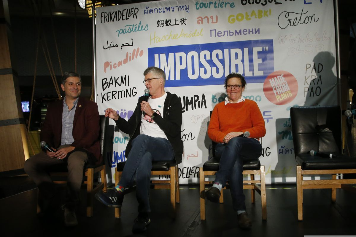 Dr. Patrick Brown, founder and CEO of Impossible Foods, the California plant-based meat company, unveils Impossible Pork and Impossible Sausage as he is flanked by Burger King CMO Fernando Machado, left, and chef and restaurant owner Traci Des Jardins, right, during a news conference before the CES tech show Monday, Jan. 6, 2020, in Las Vegas. (AP Photo/Ross D. Franklin)