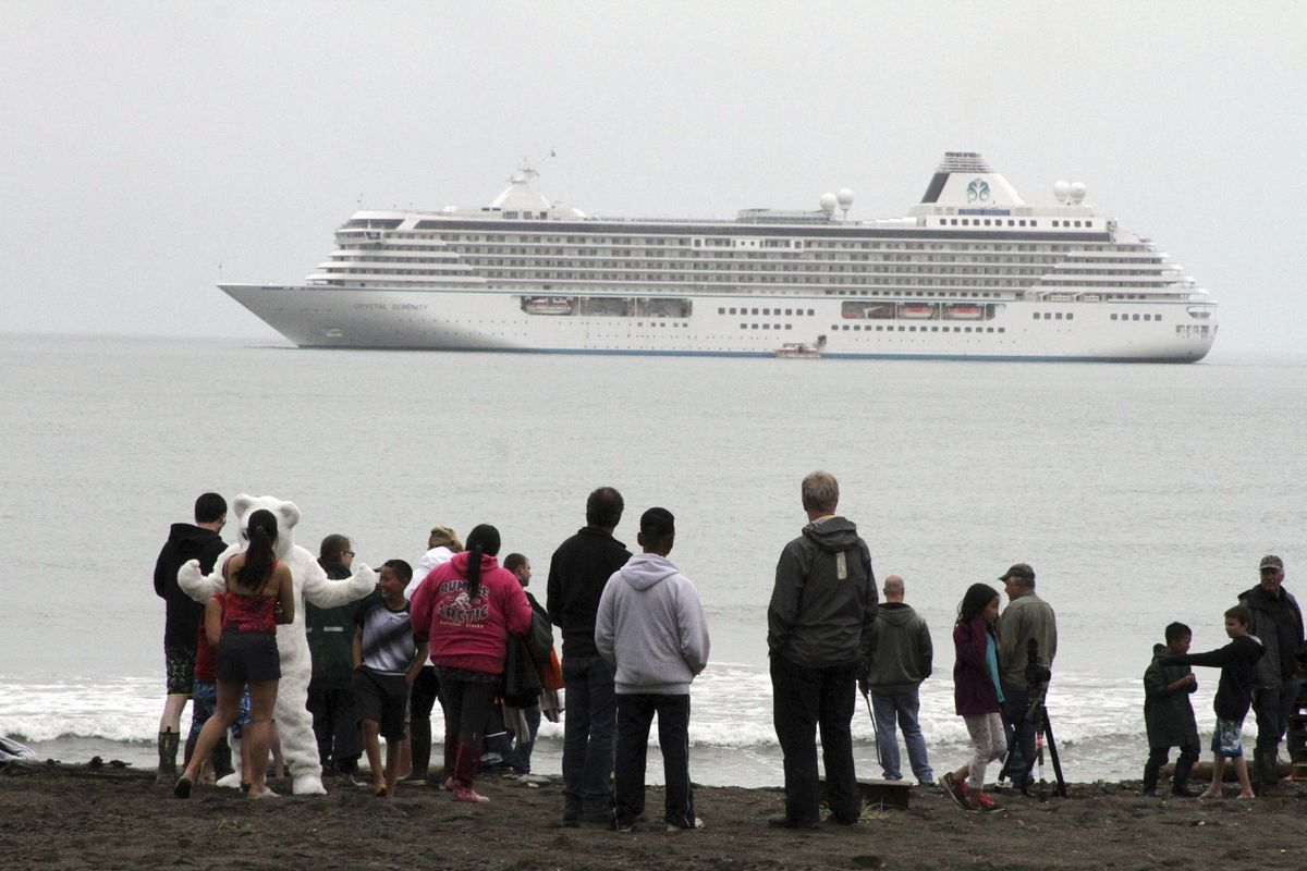 FILE - In this Aug. 21, 2016, file photo people prepare to take a polar plunge in the Bering Sea in front of the luxury cruise ship Crystal Serenity, which anchored just outside Nome, Alaska. The ship made a port call as it became the largest cruise ship to ever go through the Northwest Passage, en route to New York City. An increasing demand for Alaska cruises is prompting some cruise lines to add more and larger vessels to their Far North lineups for the 2017 tourist season. (AP Photo/Mark Thiessen, File)