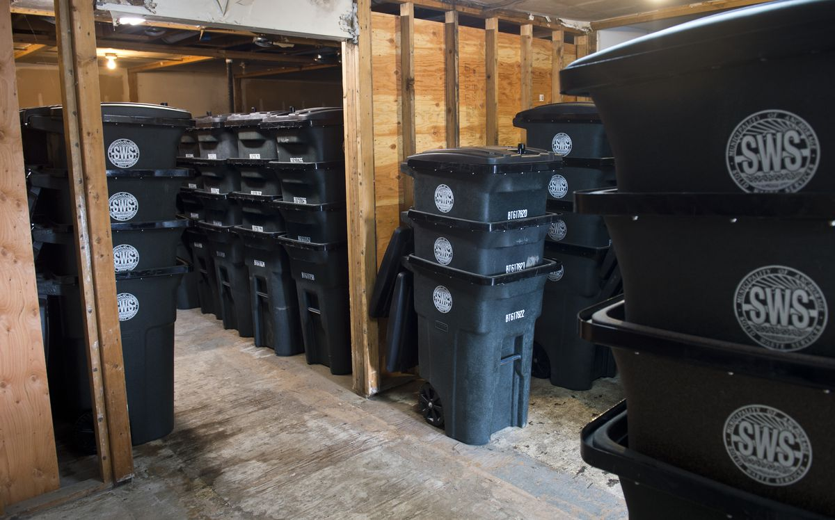 Bear resistant carts are stacked in a Solid Waste Services storage area. Anchorage's Solid Waste Services and Alaska Waste both offer bear-resistant trash carts as options. Photographed on May 29, 2019. (Marc Lester / ADN)