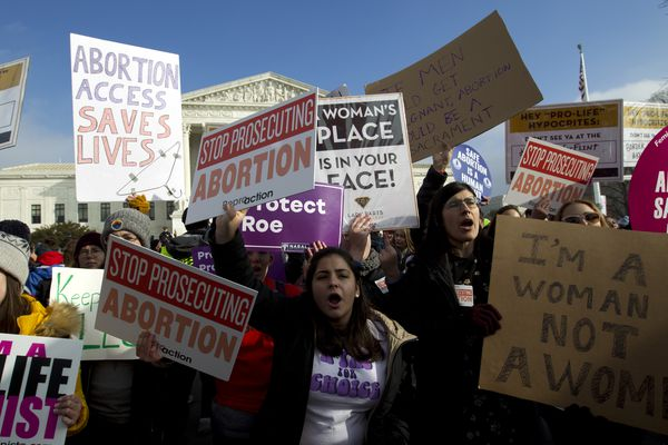 FILE - In this Jan. 18, 2019, file photo, abortion-rights activists protest outside of the U.S. Supreme Court, during the March for Life in Washington. After the Supreme Court's landmark 1973 decision in Roe v. Wade, many states began imposing restrictions on abortion clinics. (AP Photo/Jose Luis Magana, File)