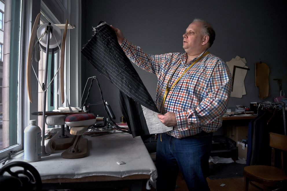Anthony Paranzino, who owns Tony the Tailor, a fine menswear shop in Charleston's historical district, has furloughed his workers and is covering 100 percent of their health insurance premiums, at a cost of $2,361 a month. (Washington Post photo by Michael S. Williamson)