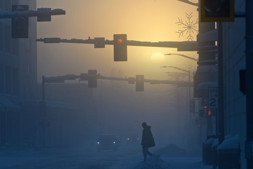 Sun shines through ice fog in downtown Fairbanks while temperatures were about minus 36 degrees on January 8, 2020. (Marc Lester / ADN)