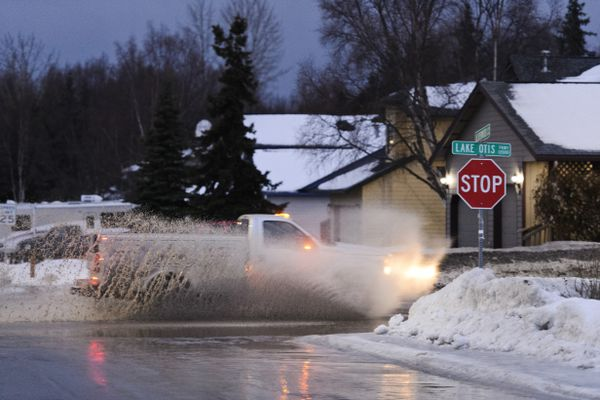 A truck drives through standing water on Lake Otis Parkway near Alderwood Loop in South Anchorage early January 25, 2019. (Marc Lester / ADN)