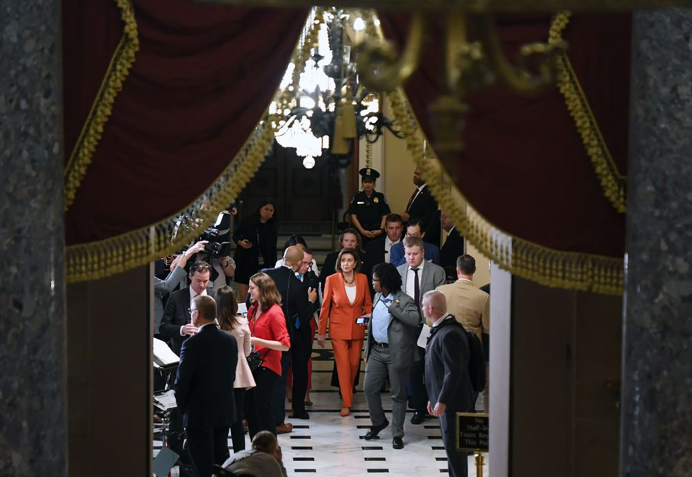 House Speaker Nancy Pelosi, D-Calif., center, walks through the Capitol following a vote on a resolution that provides procedural guidelines for the impeachment inquiry on Oct. 31, 2019. (Washington Post photo by Matt McClain)