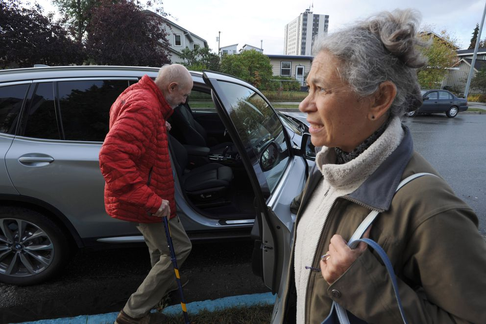 Mike Singsaas gets in the car as his wife, Rocky Plotnick, waits, Sept. 13, 2019. Singsaas lives at the Anchorage Pioneer Home but the two are looking at other options in the area. (Anne Raup / ADN)