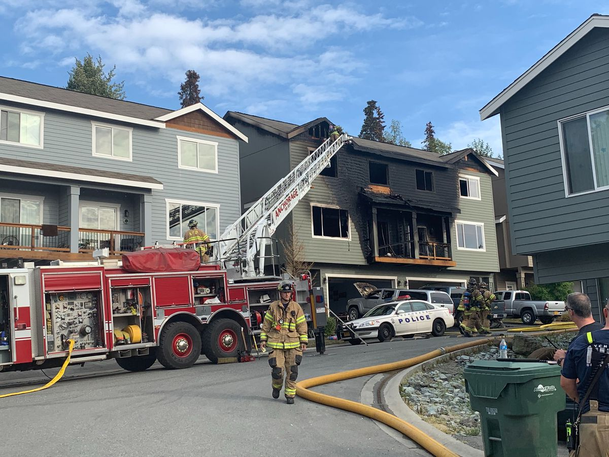 Firefighters work at the scene of a condo building fire on Vista Ridge Loop in Eagle River on Friday evening, Aug. 16, 2019. (Matt Tunseth / ADN)