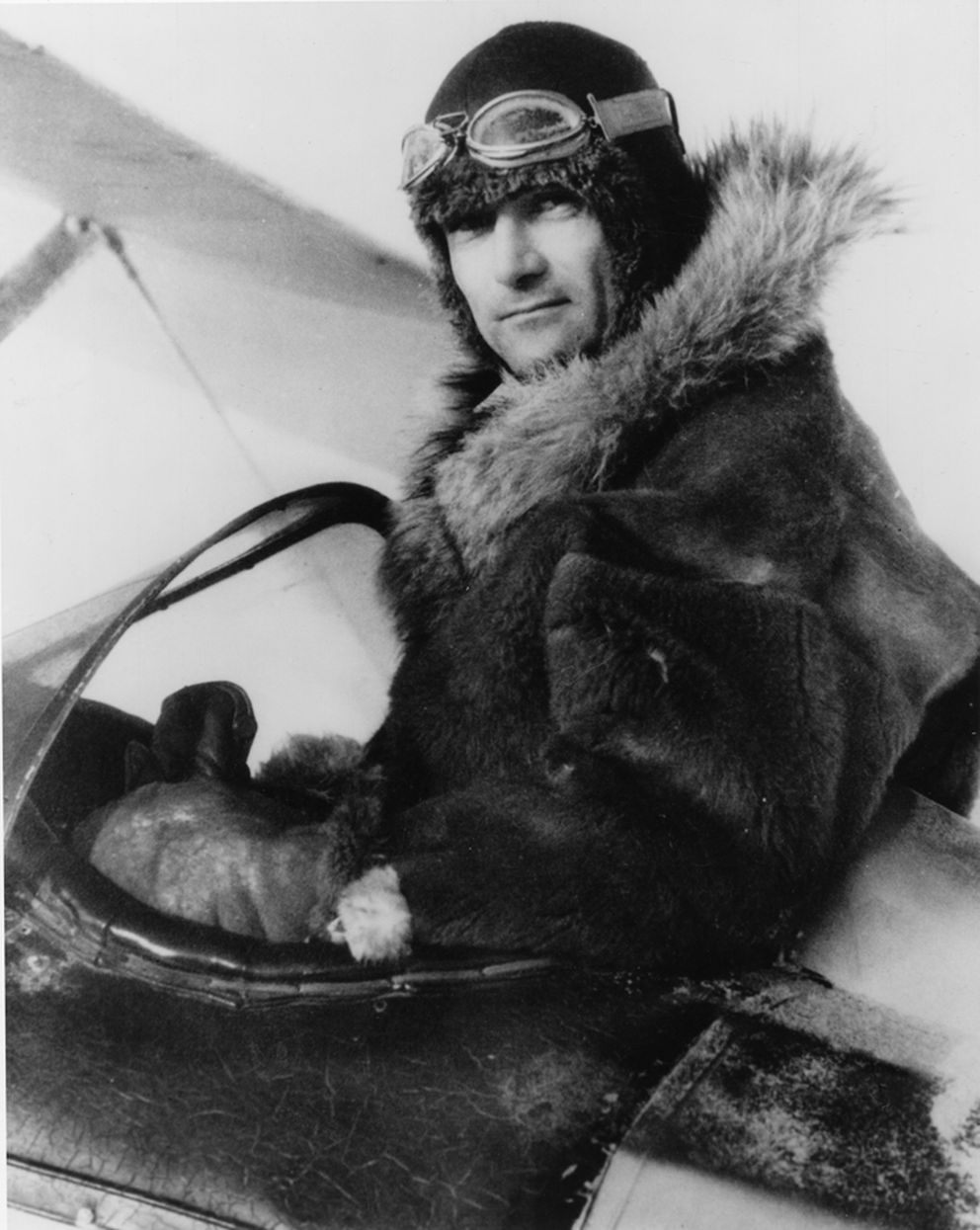 "Harold Gillam, in the cockpit of his ski-equipped Waco, circa 1920s. He was among the boldest of Alaska's pioneer bush pilots, earning the nickname ""Thrill 'em, spill 'em, no kill 'em Gillam."" He died in 1943 when he crash-landed in Misty Fjords National Monument near Ketchikan. He survived the crash, but succumbed to the January cold before searchers found him. (Anchorage Museum photo)"