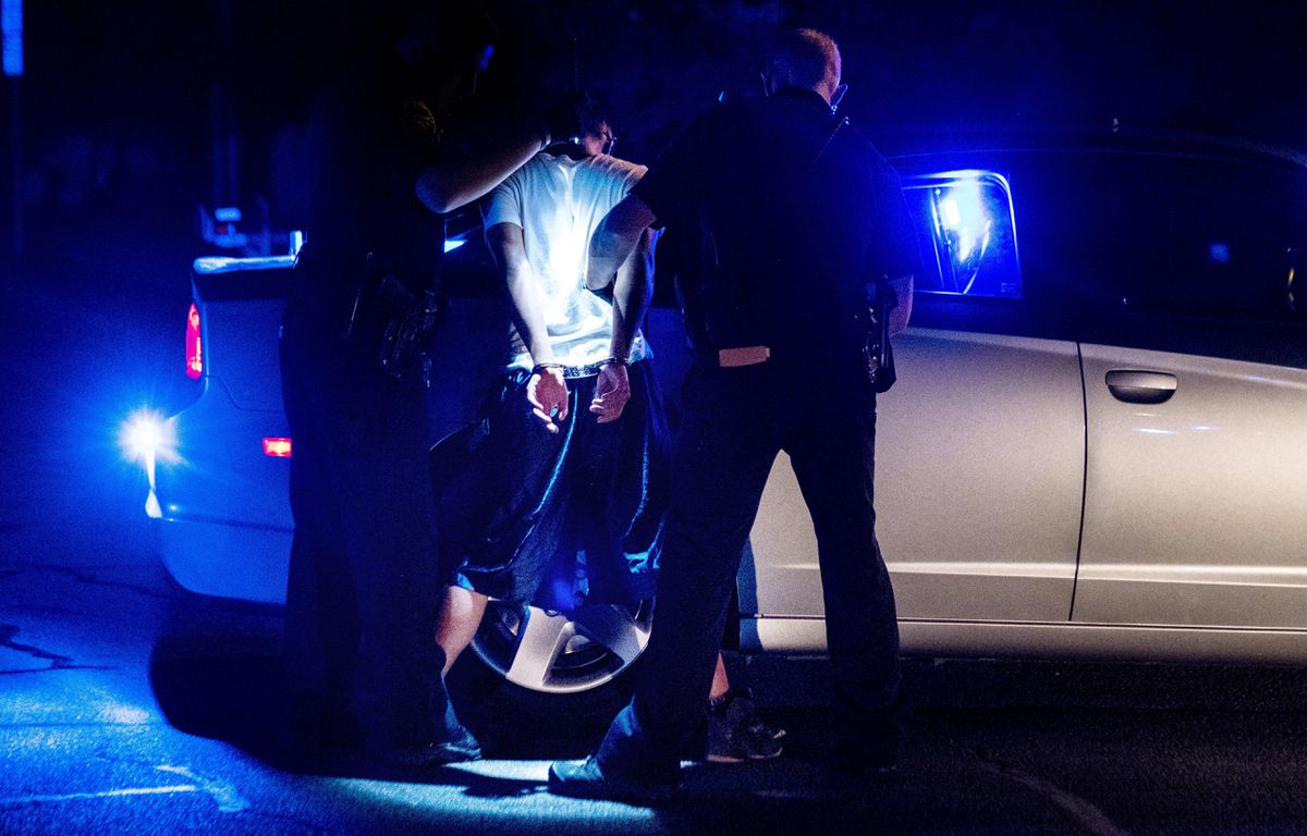 Northern Virginia Gang Task Force officers partner with ICE officers arrest an alleged MS-13 gang member in a Manassas, Va., neighborhood on August 10, 2017. Washington Post photo by Melina Mara