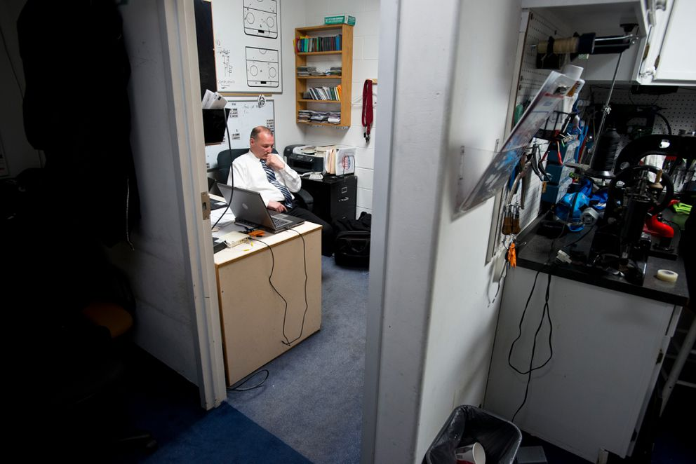 Alaska's head coach Rob Murray sits alone in his Sullivan Arena office after the first period of a game last April. (Marc Lester / Alaska Dispatch News)