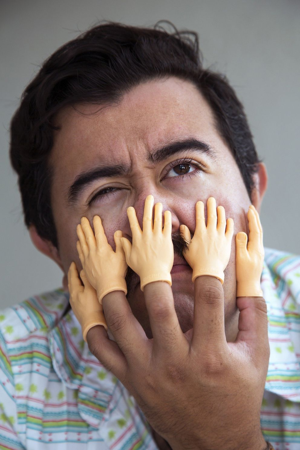 Hand Finger Puppets. Actor is Joey Flechas is photographed at Carl Juste's home. (CARL JUSTE/MIAMI HERALD/TNS)