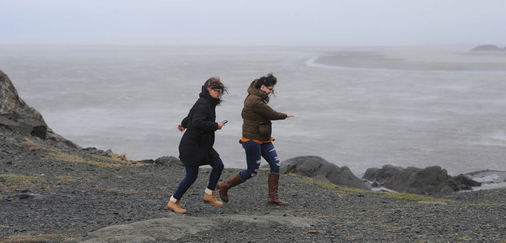 Shanna Barnes and Brooklyn Powell experience the strong winds at Beluga Point along the Turnagain Arm on Sunday, Oct. 27, 2019. (Bill Roth / ADN)