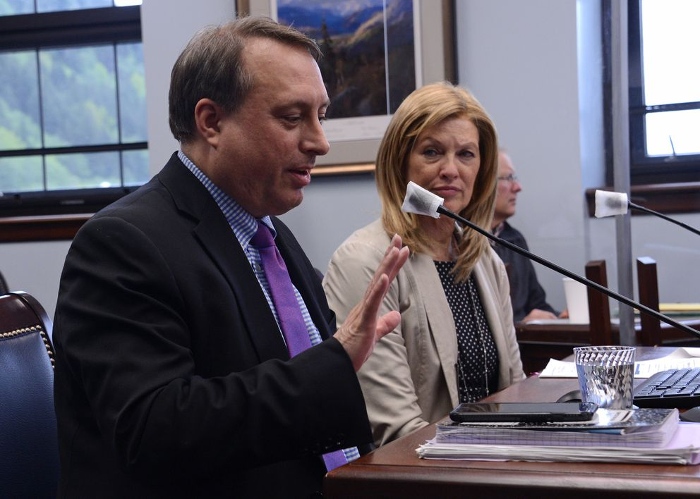 Deputy Revenue Commissioner Mike Barnhill talks on Thursday, May 27, 2021 about Gov. Mike Dunleavy's plan to change the Permanent Fund dividend. At background is Revenue Commissioner Lucinda Mahoney. (James Brooks / ADN)