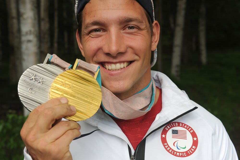 Andrew Kurka shows his gold and silver medals from the 2018 Winter Paralympics in Pyeongchang, South Korea at Goose Lake Park in Anchorage, AK on Thursday June 28, 2018. Kurka won the gold in the Downhill and the Silver in the Super-G. Kurka was at the park to participate in the bike ride with Challenge Alaska. (Bob Hallinen / ADN)