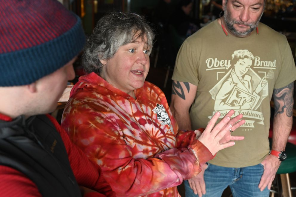 From left, Humpy's manager John Kastar, owner Lisa Fink, and bar manager Mike Lajoie talk about the city-wide restrictions on restaurants and bars in Anchorage, Monday, March 16, 2020. (Anne Raup / ADN)