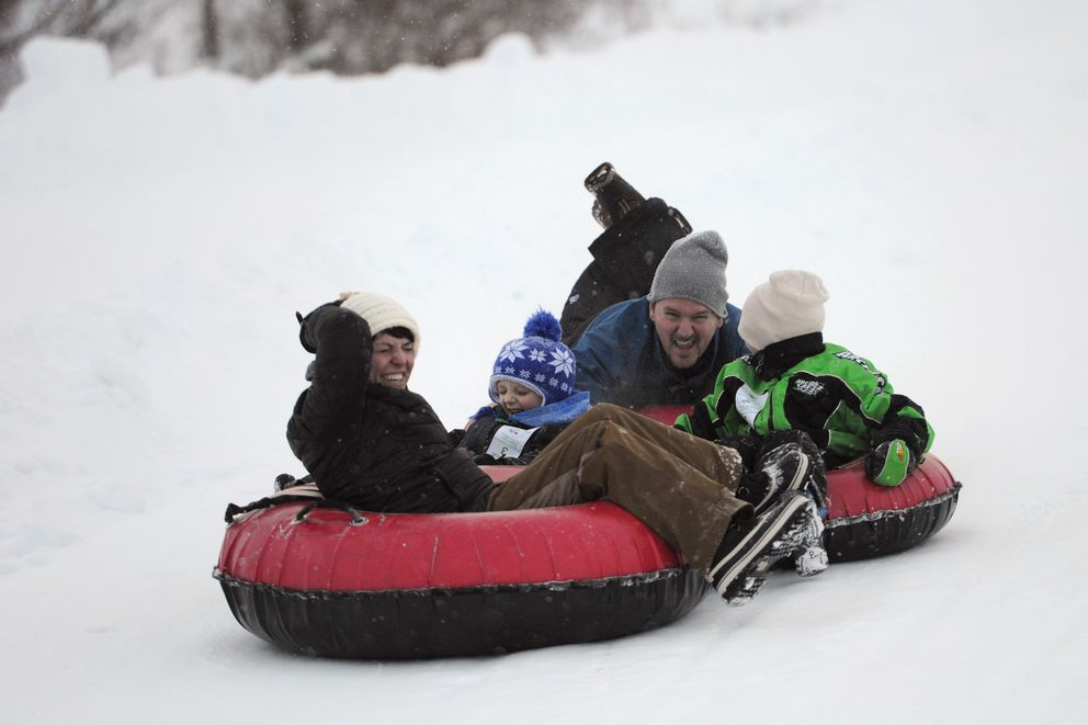 The Boylan family slides down the tube park together. (Bill Roth / ADN)