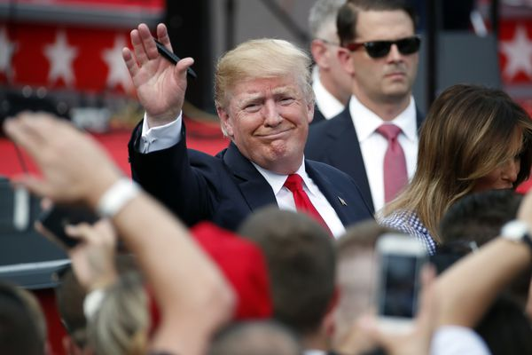 President Donald Trump, accompanied by first lady Melania Trump, waves as he greets military families during an afternoon picnic on the South Lawn of the White House, Wednesday, July 4, 2018, in Washington. (AP Photo/Alex Brandon)