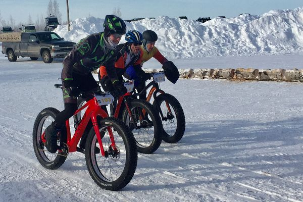 Will Ross, left, inches ahead of David Arteaga, center, and Jason Lamoreaux at the finish line of the Little Su 50K bike race on Saturday, Feb. 17, 2018. (Photo by Mary Steiert)