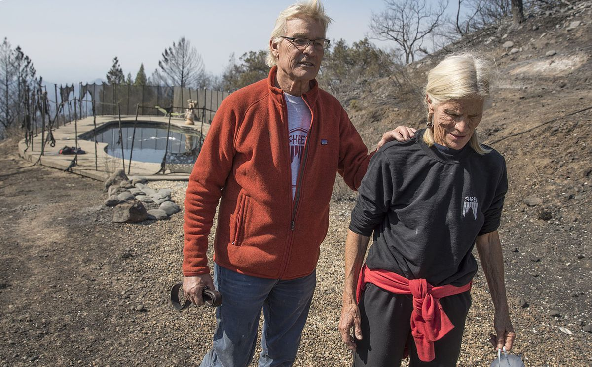 John and Jan Pascoe survived the firestorm Monday morning by running out of their home and into their neighbors' swimming pool in Santa Rosa, Calif., on Thursday, Oct. 12, 2017. (Brian van der Brug/Los Angeles Times/TNS)