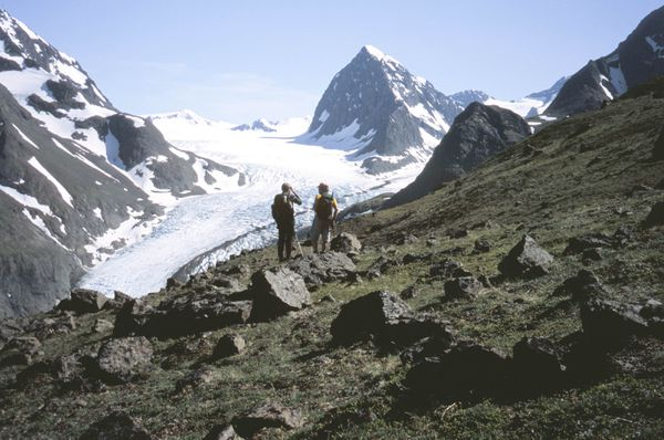 Jim Saylor, left, and Tucker Spohr in the meadows on the lower east flank of Benign Peak with Eklutna Glacier and 7,040-foot Peril Peak beyond them. (Shawn Lyons / ADN archive)