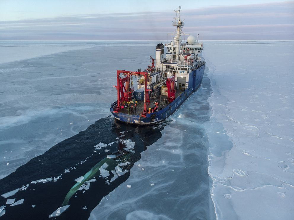 In this Nov. 14, 2019, photo provided by John Guillote and taken from an aerial drone shows the U.S. research vessel Sikuliaq as it makes its way through sea ice in the Beaufort Sea off Alaska's north coast. University of Washington scientists onboard the research vessel are studying the changes and how less sea ice will affect coastlines, which already are vulnerable to erosion because increased waves delivered by storms. More erosion would increase the chance of winter flooding in villages and danger to hunters in small boats. (John Guillote via AP)