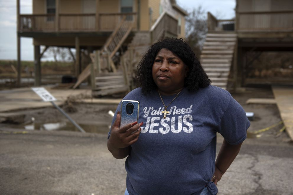Bridget Jones-Curtis, 49, looks at what remains of her Cameron, La., house after Hurricane Laura struck it last week. (Photo for The Washington Post by Callaghan O'Hare)