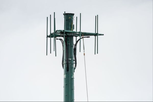 Technicians work on a new cell tower near Service High School on Saturday, October 4, 2014.