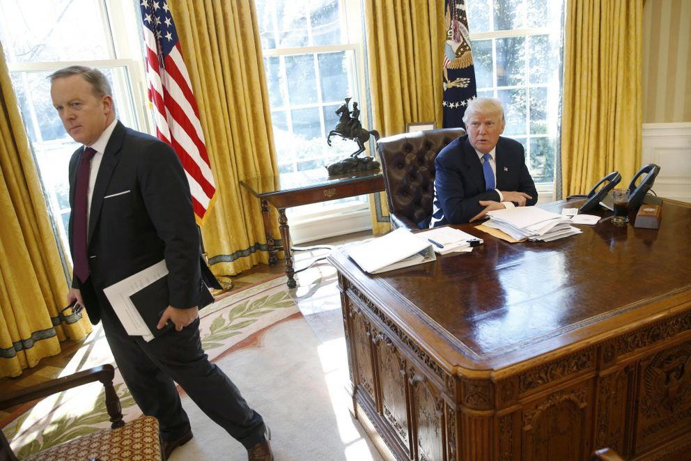 White House Communications Director and spokesman Sean Spicer with President Donald Trump in the Oval Office at the White House in Washington, February 23, 2017. REUTERS/Jonathan Ernst