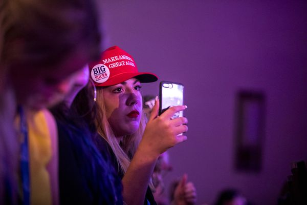 "A young Donald Trump supporter uses her phone at the Young Women's Leadership Summit, a conference organized by Turning Point USA and sponsored by the NRA, in Dallas, June 14, 2018. An estimated 1,000 young women took part in sessions like ""How Political Correctness is Making Everyone Stupid"" and displayed enthusiasm they hope to see for Republicans in the midterm elections. (Ilana Panich-Linsman/The New York Times)"