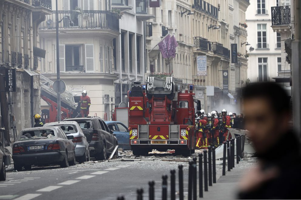 Firefighters work at the scene of a gas leak explosion in Paris, France, Saturday, Jan. 12, 2019. Paris police say several people have been injured in an explosion and fire at a bakery believed caused by a gas leak. (AP Photo/Kamil Zihnioglu)