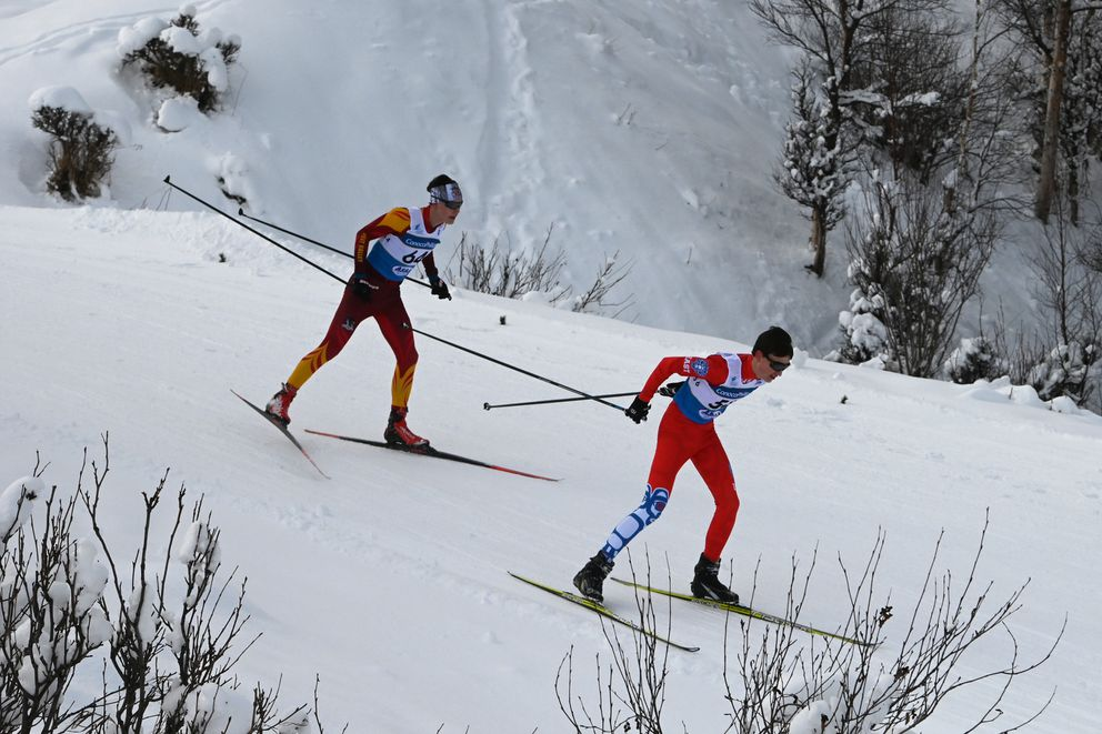 West Valley junior Luke Buth, left, and East sophomore Eli Stierwalt near the finish line. (Bill Roth / ADN)