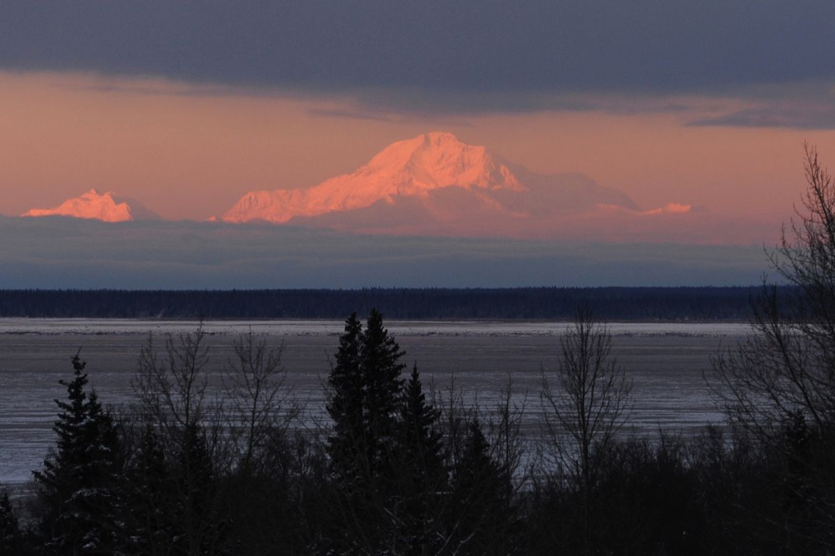 The sun sets on Denali on Dec. 28, 2016, in a view from Kincaid Park. (Erik Hill / ADN)