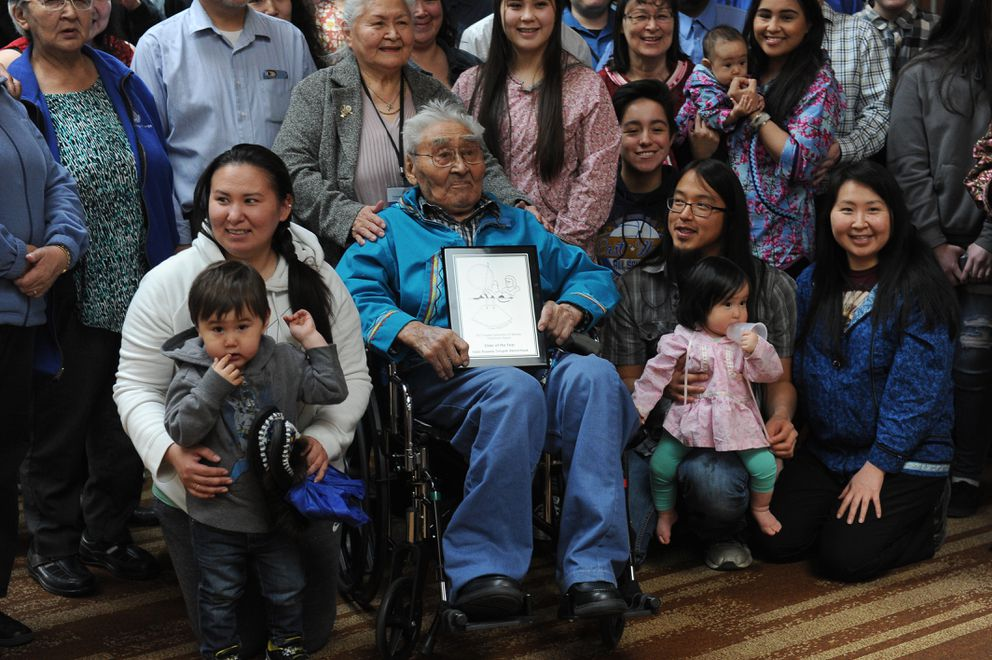 Family surrounds 95-year-old Isaac Akootchook, from Kaktovik after receiving the Elder of the Year award at the AFN convention in Anchorage. (Bob Hallinen / Alaska Dispatch News)